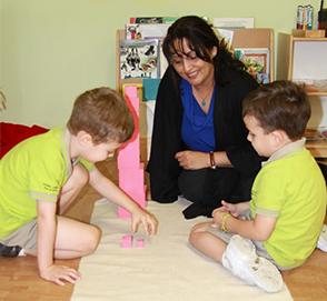 Montessori teacher with pre-schoolers